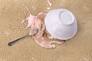5231811-a-bowl-of-spilled-neopolitan-ice-cream-on-white-carpet-that-is-melting-stock-photo