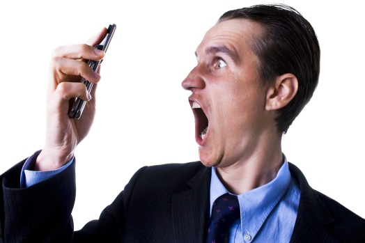 businessman looking and screaming at phone