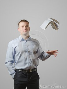 young-man-throws-book-over-his-head-white-background-53026102