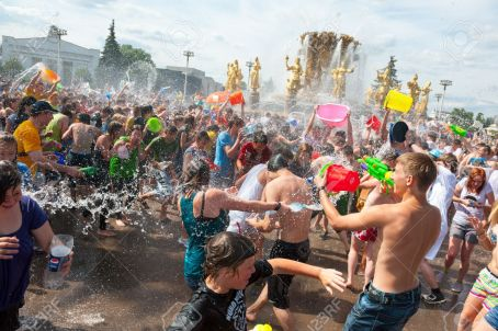 25385467-moscow-july-14-young-people-shooting-and-throwing-water-at-each-other-during-flash-mob-water-battle-stock-photo